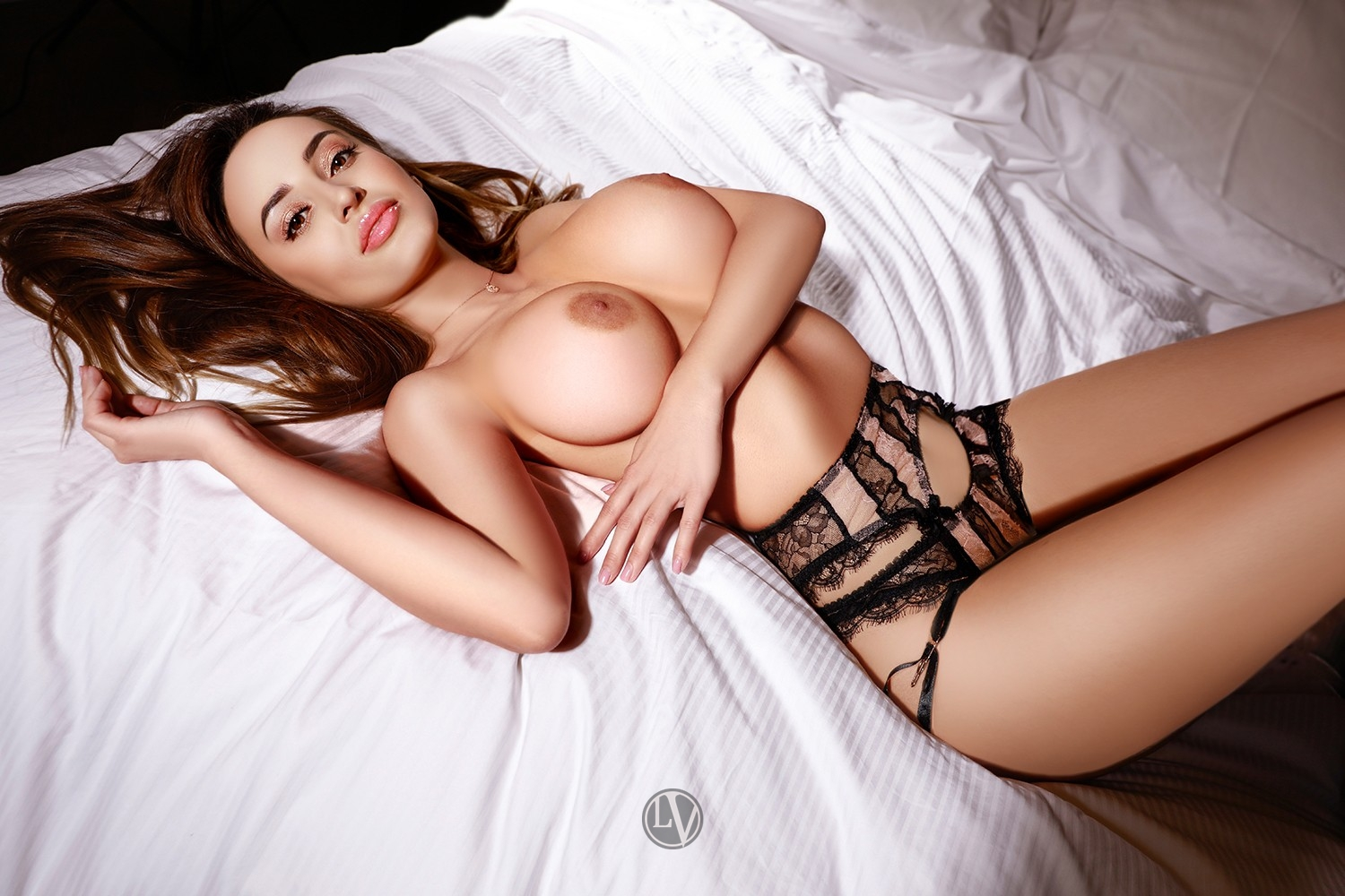 Topless Asia lying on the bed