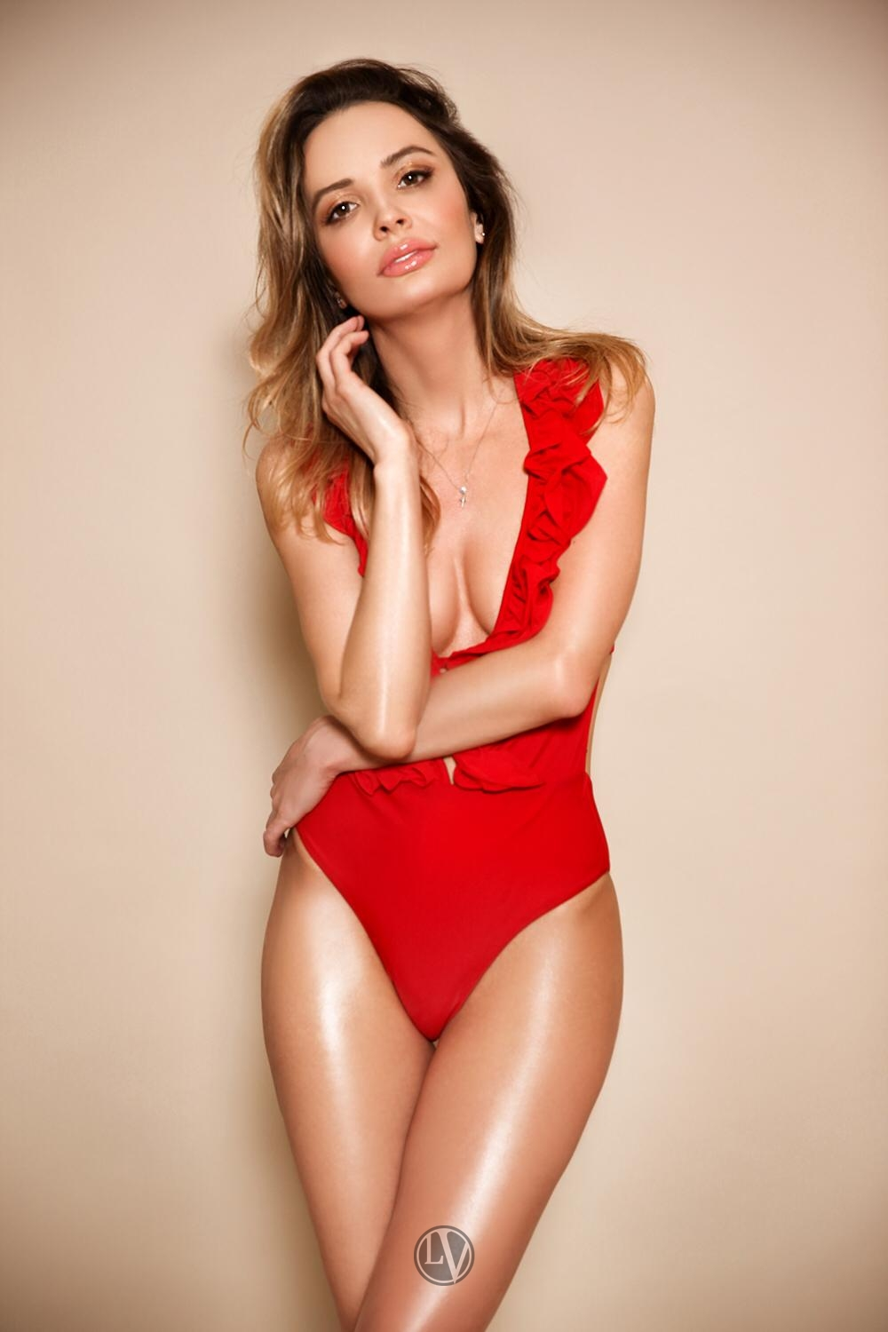 Perfectly petite escort Finley in her red swimsuit