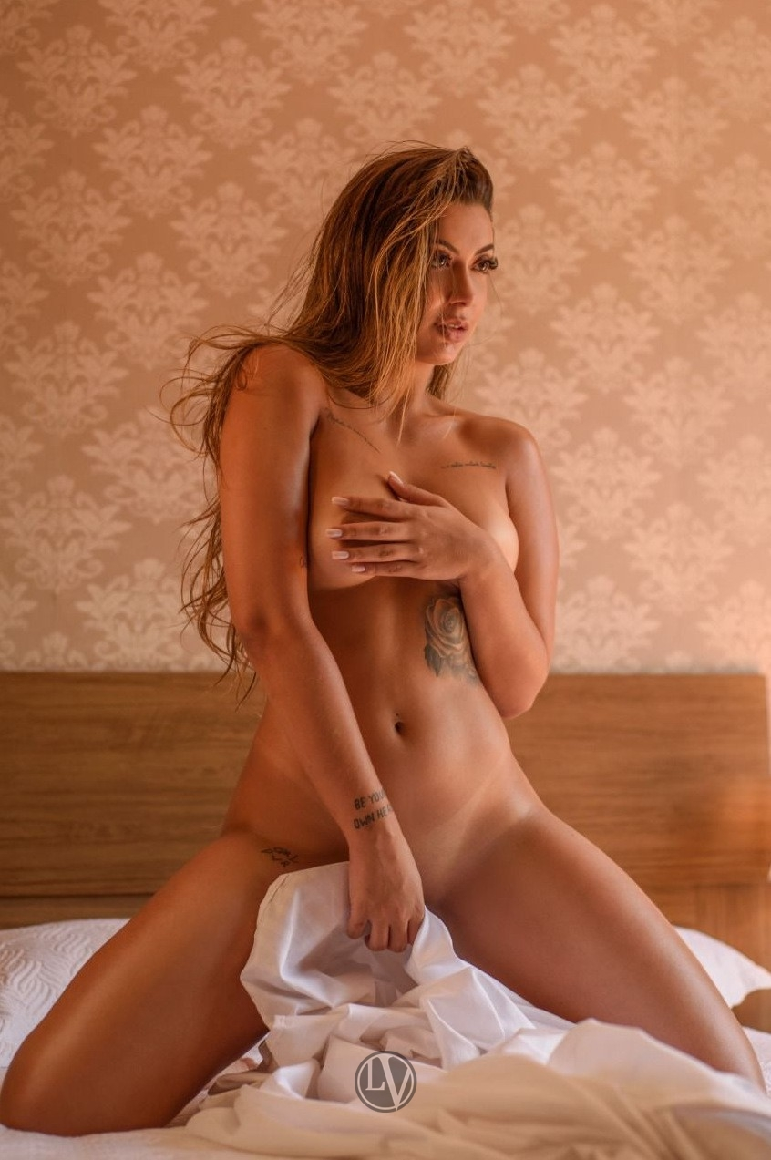 A topless photo of gorgeous high end London escort Ingrid