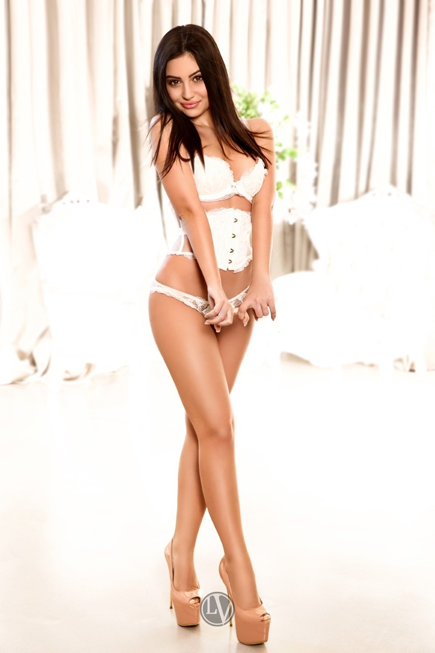Paulina in her white lingerie and high heels