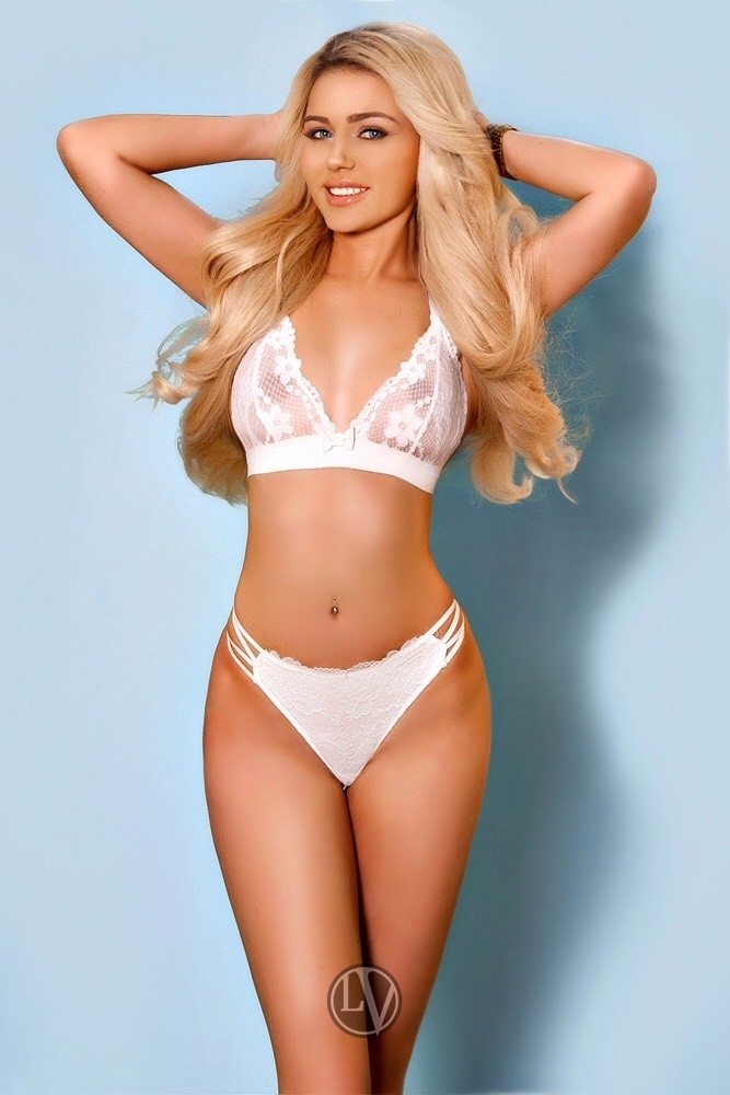 Hit London escort girl Dixie in white bra and knickers