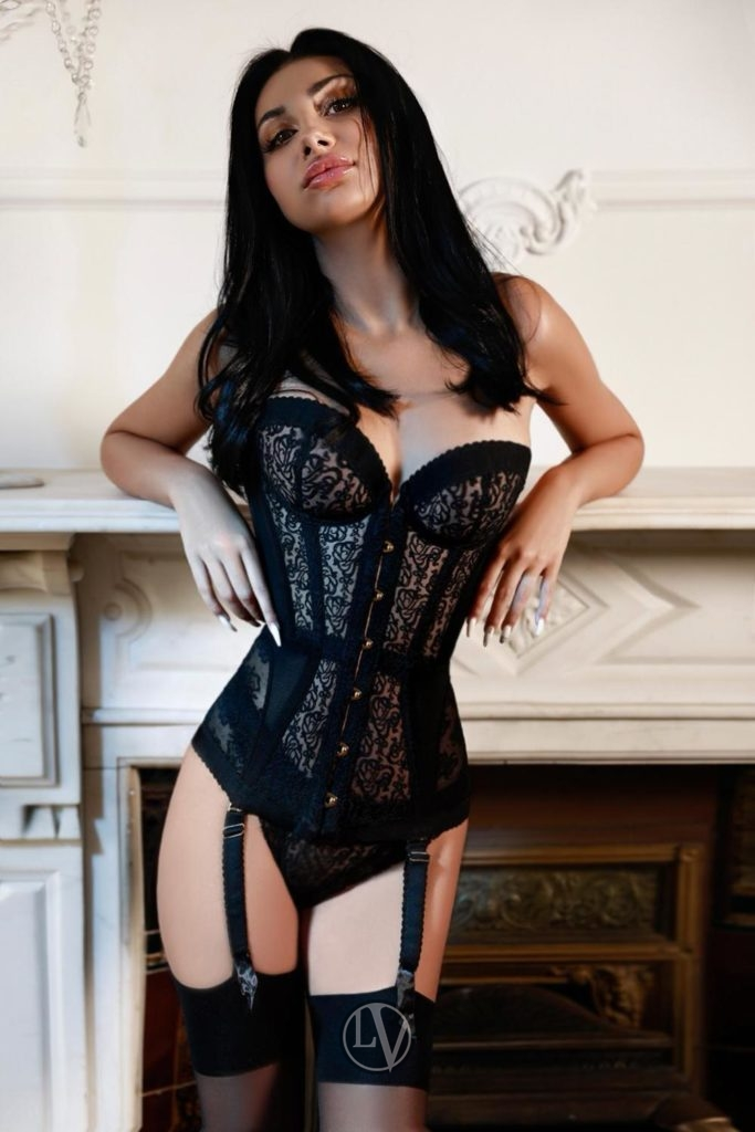 Tall escort Audrey in a designer corset and stockings