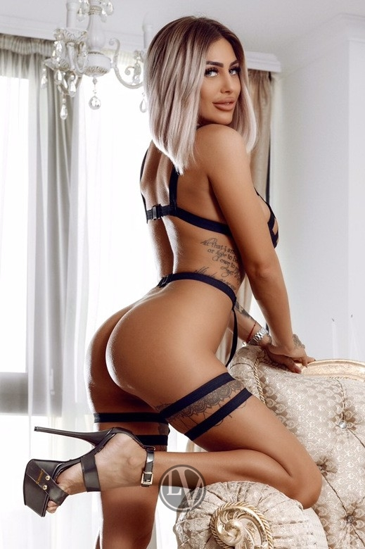 Dione dressed in her naughty little outfit for her London escort photoshoot