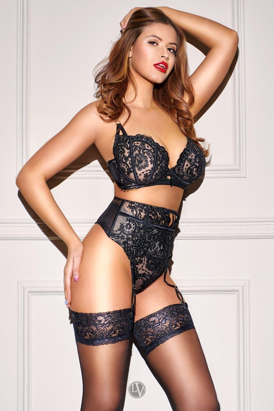 Sexy Brazilian escort Kim in her designer black lingerie and stockings.