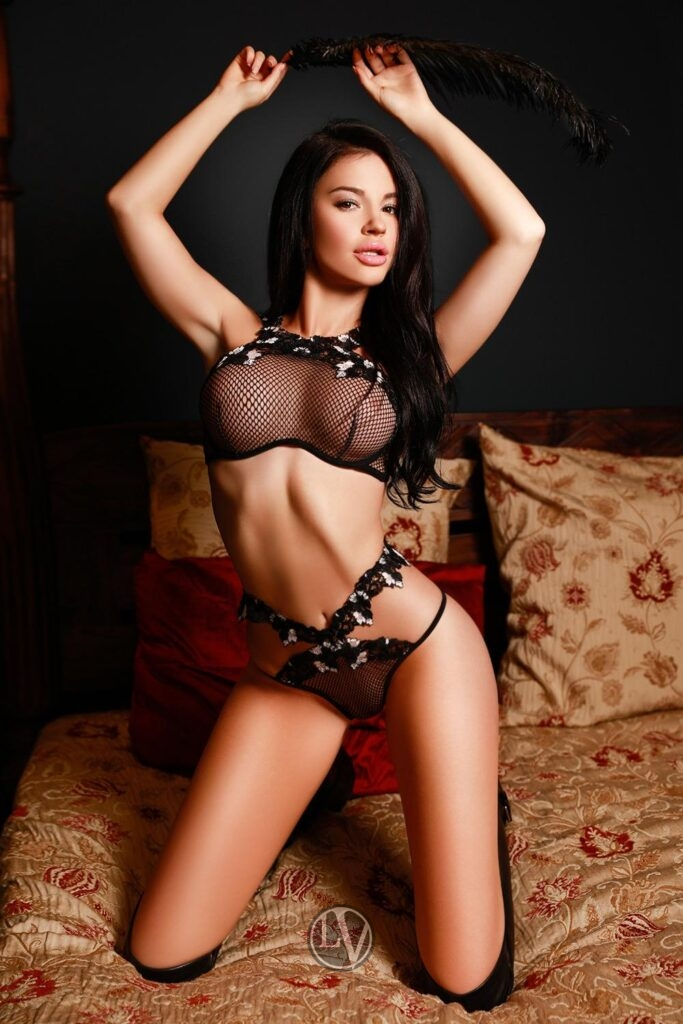 Busty brunette escort Jules in her fetish lingerie.