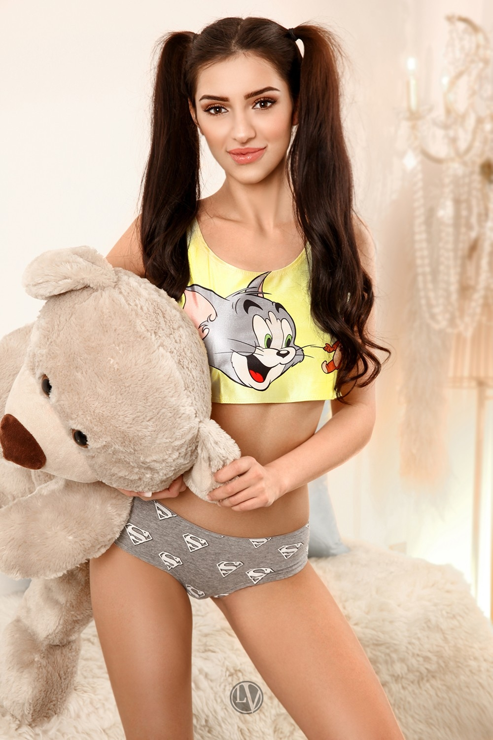 Young escort Wren in her night wear holding a teddy.