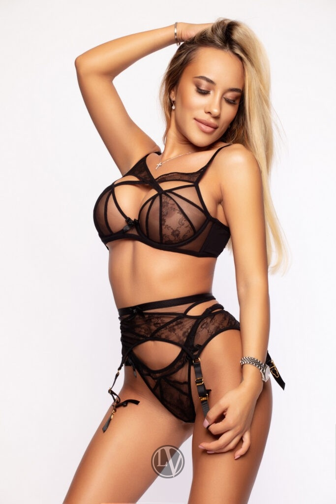 Escort Denie in her sexy black lingerie set.