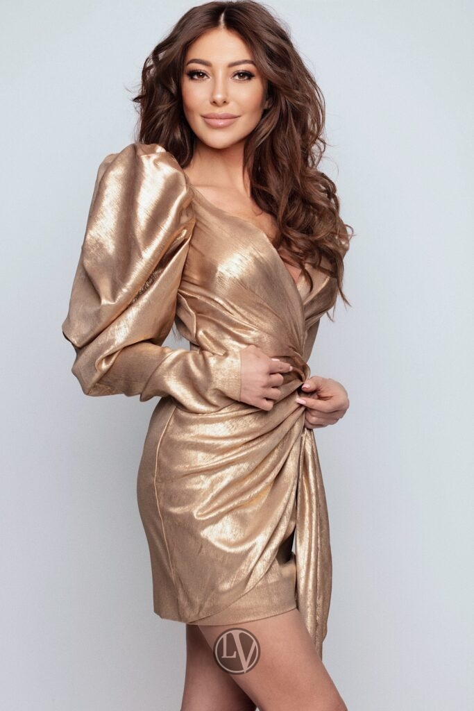 Escort Nadine in her designer gold dress