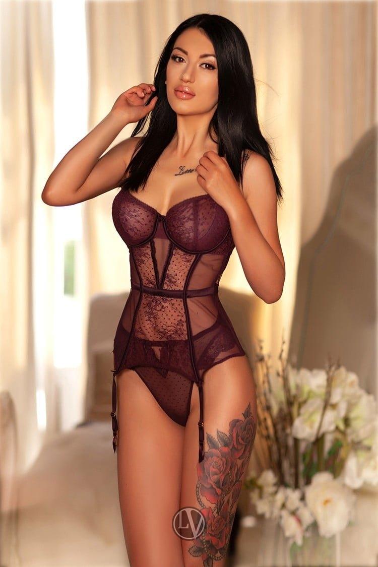 Escort Drew in her designer black lingerie