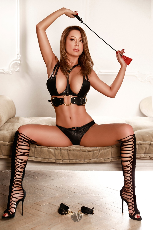 Fetish escort Grace in her black bondage gear