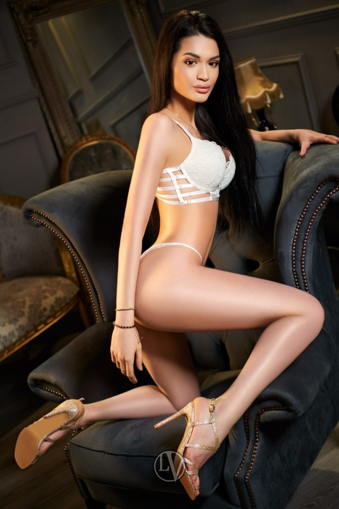 Top London escort Delta posing in white underwear on a chair