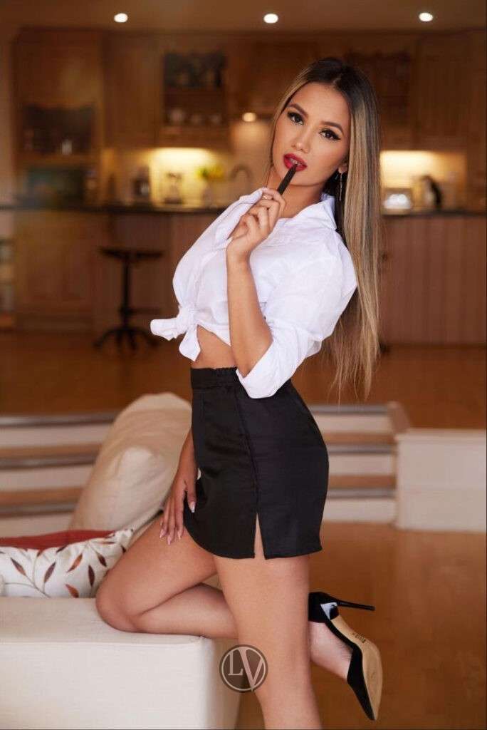 Beautiful blonde London escort Katherine showing off her sexy figure and model looks