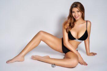 London escort Kim sitting on the floor in her underwear.
