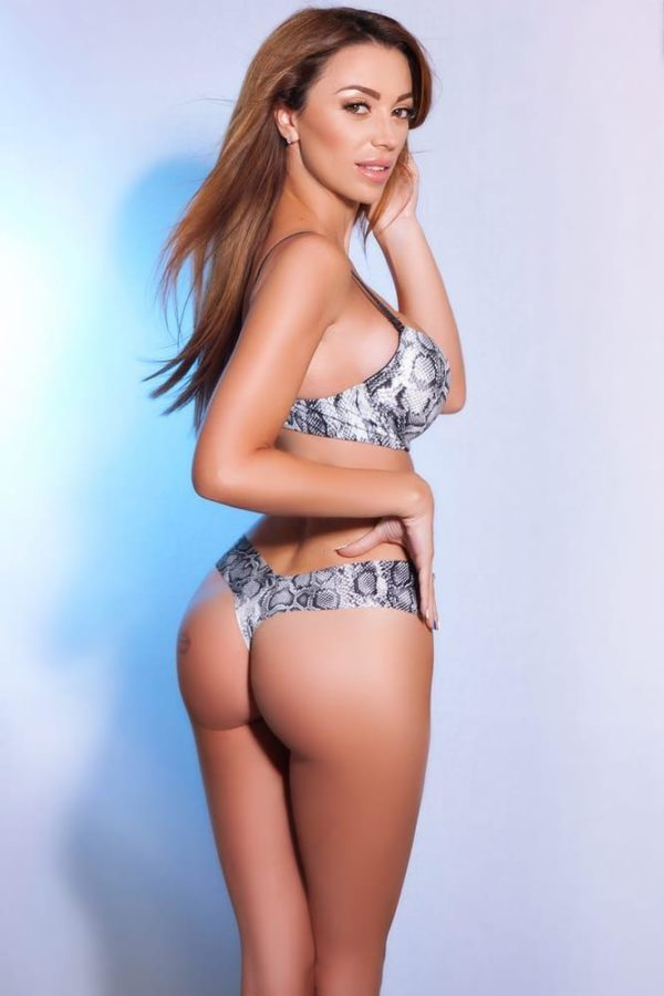 Top London escort Courtney in her skimpy bathing suit