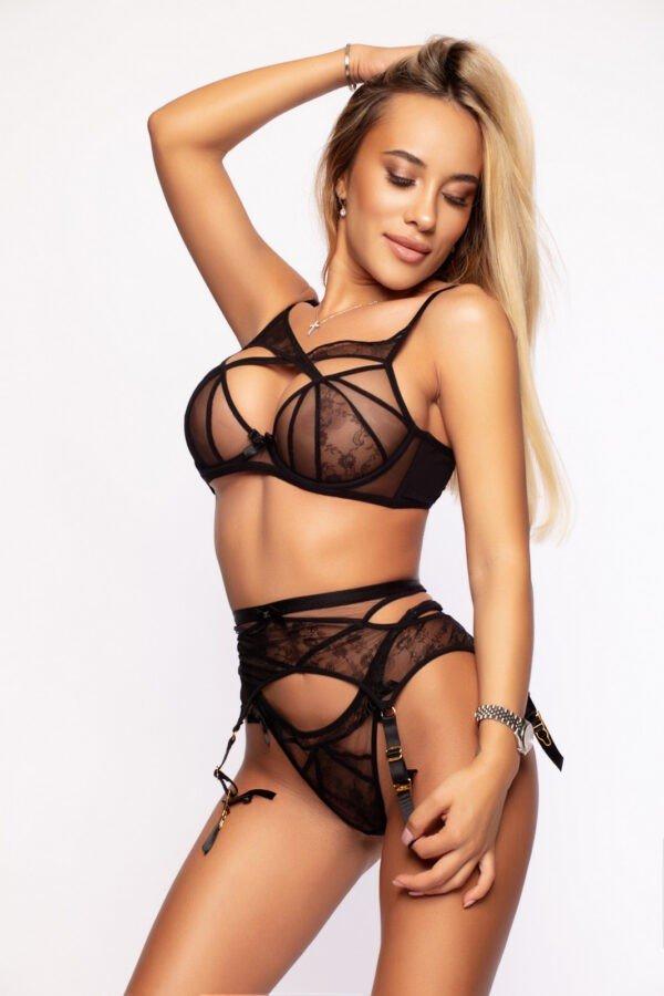 Escort Denie in her sexy black lingerie set.